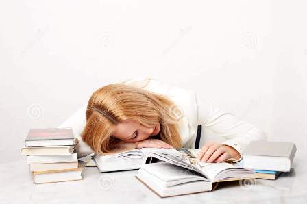 http://www.dreamstime.com/royalty-free-stock-image-young-woman-falling-asleep-studying-image13837466